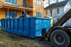 dumpster near a home